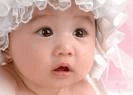 baby in ruffly bonnet