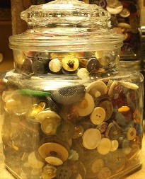 A large glass jar full of buttons, from our