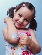 little girl pointing to her elbow