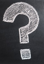 Question mark written on a chalkboard