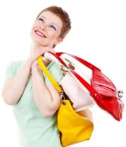 Happy woman shopper with purses
