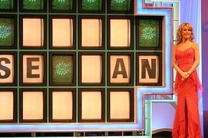 Vanna White and Wheel of Fortune game